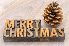 圣诞快乐在木类型的贺卡 免版税库存照片