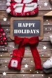 圣诞快乐在红色、白色和木头-葡萄酒s的贺卡 免版税图库摄影