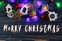 圣诞快乐在诗歌选的文本标志点燃边界ang金黄t 库存图片
