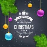 圣诞快乐在黑板的问候商标 免版税库存图片