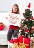 圣诞快乐愿望一个小女孩 免版税库存照片