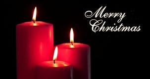 圣诞快乐文本和发光的红色蜡烛 影视素材