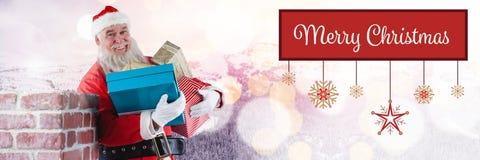 圣诞快乐文本和圣诞老人与礼物 免版税库存图片