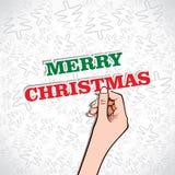 圣诞快乐文本在手中 免版税图库摄影