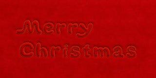 圣诞快乐文本天鹅绒背景 库存图片