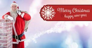 圣诞快乐新年快乐文本和圣诞老人与大袋由烟囱 库存照片
