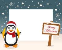 圣诞快乐标志框架-企鹅 库存照片