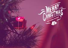 圣诞快乐消息的数字式综合图象反对圣诞节装饰的 免版税库存照片