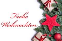 圣诞快乐用在红色的德语在圣诞节背景borde 库存图片