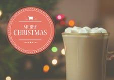 圣诞快乐的数字式综合图象反对一个杯子的热巧克力 库存图片
