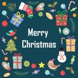 圣诞快乐词组在蓝色背景的 免版税库存图片