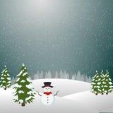 圣诞快乐风景,雪人在冬天 免版税库存照片