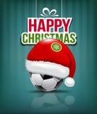 圣诞快乐,在足球的圣诞老人帽子 库存图片