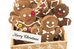 圣诞快乐贺卡用姜饼曲奇饼 免版税库存照片