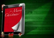 圣诞快乐-片剂计算机 库存照片