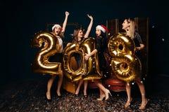 圣诞晚会的跳舞妇女 免版税库存照片