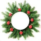 圣诞树分支和红色lolipop作为在白色背景的装饰 在视图之上 库存照片