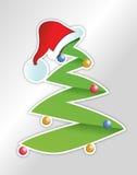 圣诞树和圣诞老人的帽子贴纸 免版税库存照片