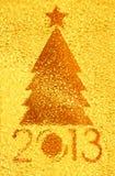 圣诞树水晶金黄背景 库存图片