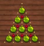 圣诞树由中看不中用的物品制成在木背景 免版税图库摄影