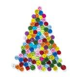 圣诞树由木被雕刻的和塑料按钮制成 免版税库存图片