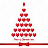 圣诞树由红色心脏做成 红色弓,丝带 圣诞快乐,新年 库存照片