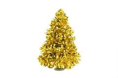 圣诞树由金黄发光的闪亮金属片制成 库存图片