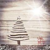 圣诞树从在木闪耀的灰色背景的棍子安排了 库存照片