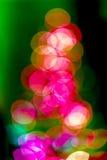 圣诞树bokeh背景 闪烁和光摘要 免版税库存图片