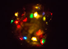 圣诞灯创造五颜六色的bokeh 免版税库存图片