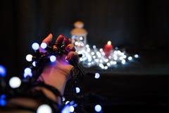 圣诞灯电灯泡在手上 图库摄影