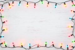 圣诞灯电灯泡框架装饰 免版税库存照片