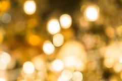 圣诞灯被弄脏的抽象背景  明亮地发光的橙黄球和线 E 图库摄影