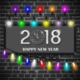 圣诞灯装饰在黑砖墙背景设置了 新年2018年概念 图库摄影