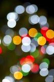 圣诞灯水平的圆颜色背景彩虹 库存图片