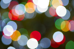 圣诞灯水平的圆颜色背景彩虹 免版税库存图片