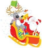 圣诞老人、驯鹿和雪人 库存照片