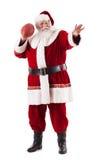 圣诞老人举行橄榄球并且准备投掷 免版税库存图片