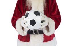 圣诞老人举行经典橄榄球 免版税库存照片