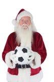 圣诞老人举行经典橄榄球 库存照片