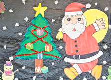圣诞老人书刊上的图片 免版税库存照片