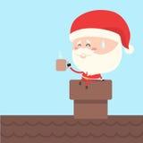 圣诞老人作为在烟囱的咖啡休息 免版税库存照片