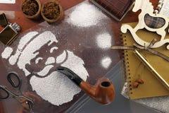 圣诞老人做了雪浪花烟斗 免版税库存照片