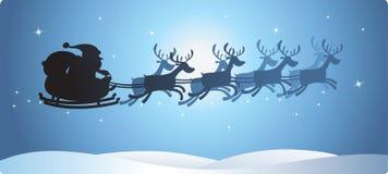 圣诞老人剪影雪橇 免版税库存照片
