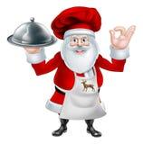 圣诞老人厨师圣诞晚餐概念 库存照片