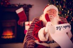 圣诞老人名单的综合图象 免版税库存照片