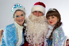 圣诞老人和两雪未婚照片  免版税库存照片