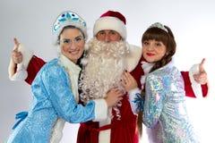 圣诞老人和两雪未婚的图象 免版税库存照片