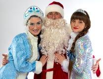 圣诞老人和两雪未婚画象  库存图片