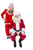 圣诞老人和克劳斯夫人微笑对照相机的 免版税库存图片